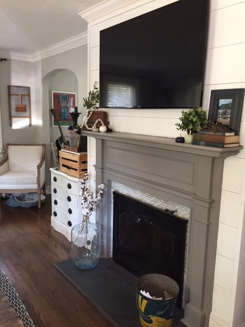 fireplace with tv mounted above it
