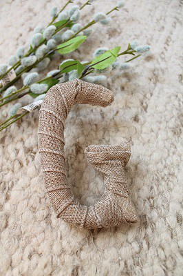 the letter G wrapped in burlap