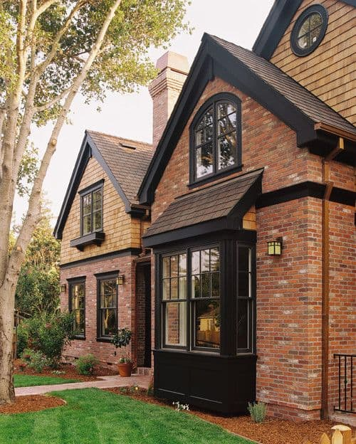 white brick ranch house black trim