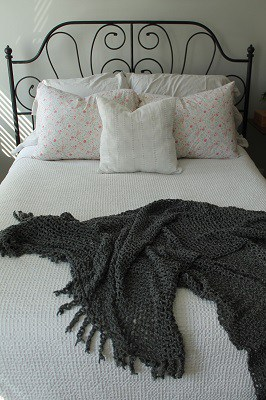 bed-with-pillows-and-gray-blanket