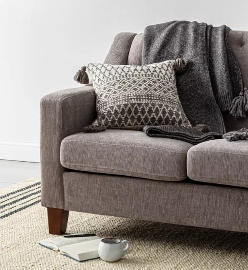 gray couch and rug